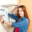 Woman near power control — Stock Photo #61574367