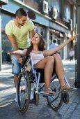 Husband taking spouse on wheelchair — Stock Photo