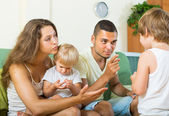 Couple scolding little daughter — Stock Photo