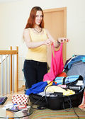 Woman preparing for vacations — Stock Photo