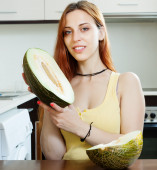 Woman holding melon — Stock Photo