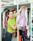 Woman arranging clothes — Stock Photo