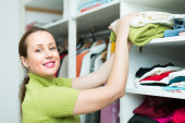 Female choosing apparel — Stock Photo