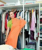 Housewife arranging clothes — Stock Photo