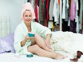 Woman putting cream — Stock Photo