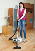 Woman cleaning with vacuum — Stock Photo