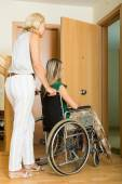 Woman helping handicapped girl — Stock Photo