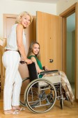 Woman helping handicapped — Stock Photo