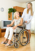 Smiling woman in wheelchair — Stock Photo