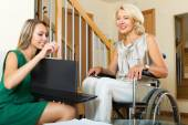 Agent and disabled woman — Stock Photo