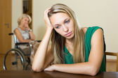 Upset woman and handicapped — Stock Photo