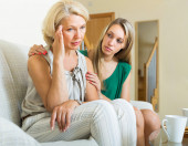 Mother reconciling with daughter — Stock Photo