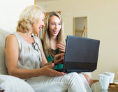Daughter and mother with laptop — Stock Photo