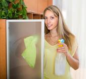 Girl cleaning at home — Stock Photo