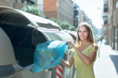 Woman with trash — Stock Photo