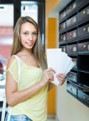 Woman at letter box — Stock Photo