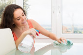 Woman cleaning table — Stock Photo