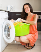 Woman at washing machine — Stock Photo