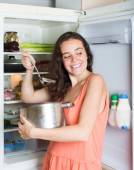 Hungry girl eating from pan — Stock Photo