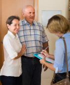 Senior couple with social worker — Stock Photo