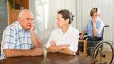 Mature couple and disabled — Stock Photo