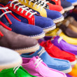 Sport shoes at fashionable shop — Stock Photo #64253847
