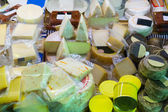 Assortment of cheese at market stand — Stock Photo