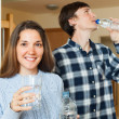 Couple  drinking clean water — Stock Photo #64287745