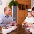 Family playing cards — Stock Photo #64280123