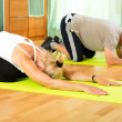 Постер, плакат: Pensioners doing exercises indoor