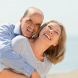 Elderly smiling couple hugging — Stock Photo #64282477