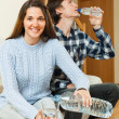 Couple drinking water from bottles — Stock Photo #64287761