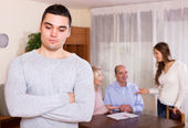 Upset man against united family — Stock Photo