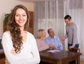 Girl staying near family members — Stock Photo