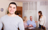 Smiling guy and big family — Stock Photo