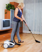 Woman cleaning living room — Stock Photo