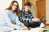 Happy  couple preparing for exam together  — Stock Photo