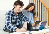 Couple unhappy students learning for exam  — Stock Photo