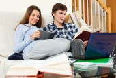Man and woman preparing for exams — Stock Photo