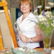 Female artist painting a picture — Stock Photo #64291877