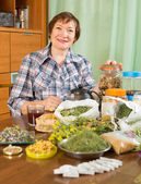 Mature woman with medicinal herbs — Stock Photo