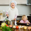 Two little sisters at home kitchen — Stock Photo #64303533