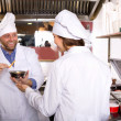 Professional chefs working at take-away — Stock Photo #64301507
