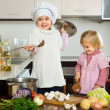 Two little sisters at home kitchen — Stock Photo #64303485