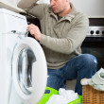Man doing laundry — Stock Photo #64304667