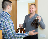 Friends gathering to drink beer — Stock Photo