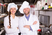 Cooks cooking at professional kitchen — Stock Photo