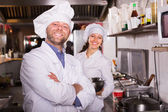 Cooks greeting customers at bistro — Stock Photo