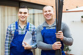 Happy professional workers in uniform — Stock Photo