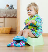 Baby girl sitting on potty   — Stock Photo